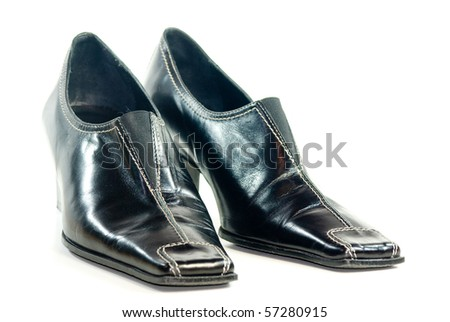 A pair of black leather shoes - stock photo