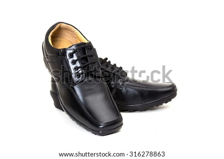 a pair of black leather shoes for men isolated on white available with clipping path - stock photo