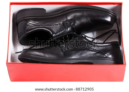 A pair of black men shoes in a red box isolated over white background - stock photo