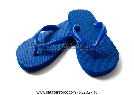 a pair of blue flipflops on a white background - stock photo