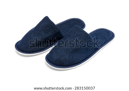A pair of blue slippers on a white background - stock photo