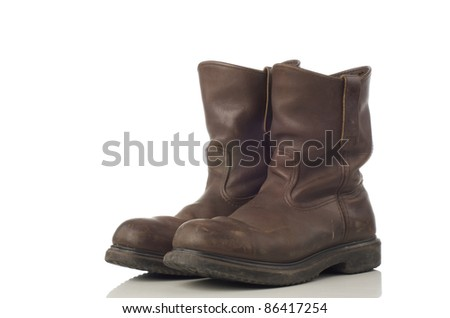 A pair of brown safety shoes - stock photo