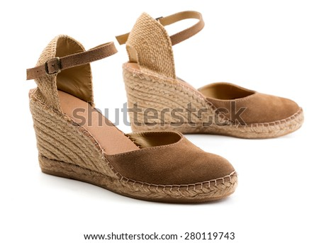 A pair of brown suede women's shoes. Isolate on white. - stock photo