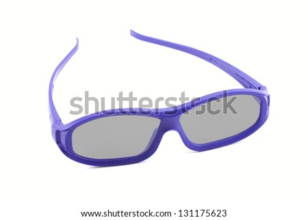 A pair of disposable 3D movie glasses isolated against a white background - stock photo