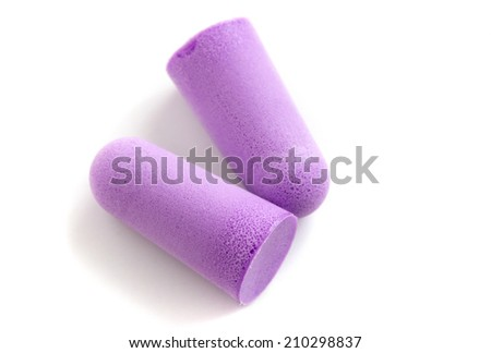 A pair of ear stoppers for protection against noise or water, isolated on a white background. - stock photo