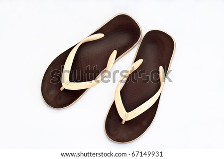 a pair of flip-flops isolated on a white background. - stock photo