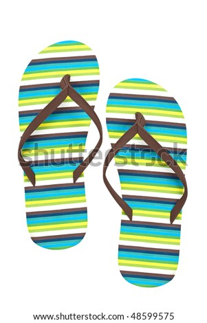 A pair of flip flops or beach sandals isolated on white background - stock photo