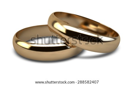 A pair of gold wedding rings resting on an isolated white background - stock photo