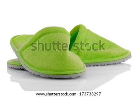 A pair of green slippers on a white background. - stock photo