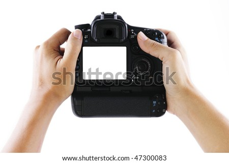 A pair of hands holding a digital camera. Clipping path included for the LCD screen. - stock photo