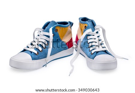 A pair of high top color denim gymshoes on a white background - stock photo