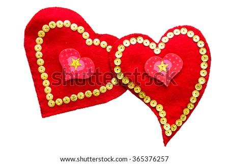 a pair of loving hearts handmade from felt isolated  - stock photo