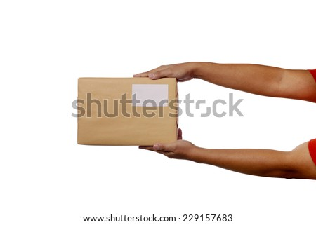 A pair of male hands holding a brown package box, isolated against white. - stock photo