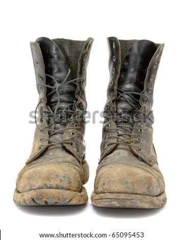 A pair of muddy boots - stock photo