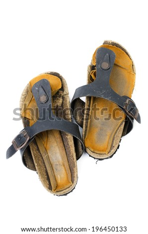 A pair of old worn out slippers on top view - isolated over white background .  - stock photo