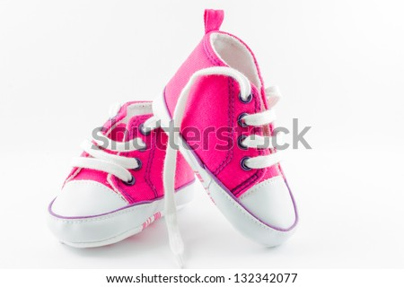 A pair of pink baby sneakers - stock photo
