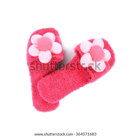 A pair of pink slippers on a white background/top view - stock photo