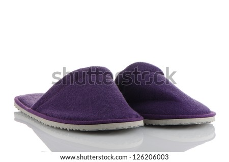 A pair of purple slippers on a white background. - stock photo