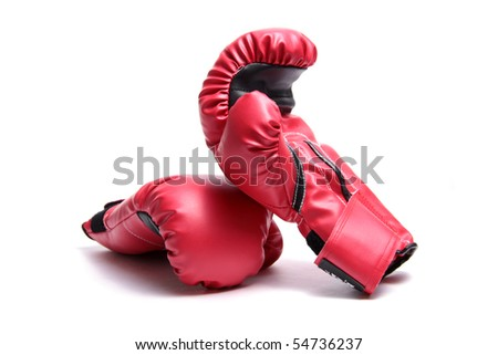 A pair of red boxing gloves on a white background. - stock photo