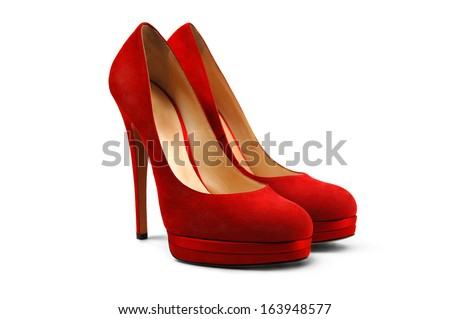 A pair of red female shoes on a white background. - stock photo
