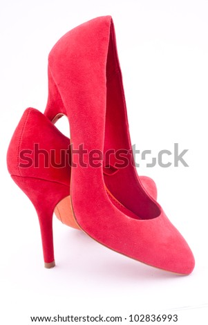 a pair of red heel shoes - stock photo