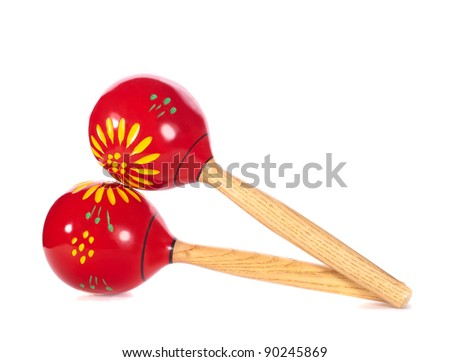 A pair of red maracas isolated on white background. - stock photo