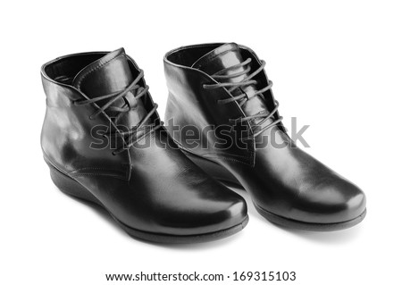 A pair of shiny black leather women shoes with laces, isolated on white background - stock photo