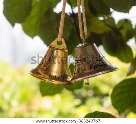 a pair of shiny decorative bronze bells - stock photo