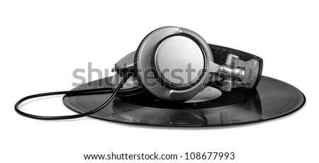 A pair of silver DJ style headphones on top of a vinyl record isolated on white. - stock photo