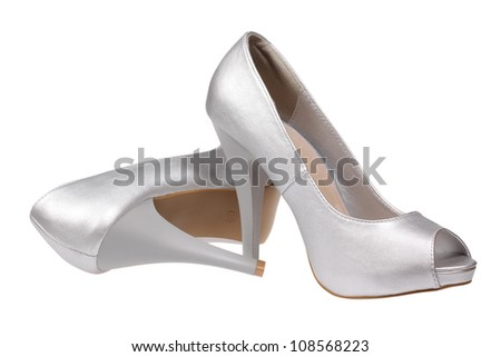 A pair of silver women's heel shoes isolated over white with clipping path. - stock photo