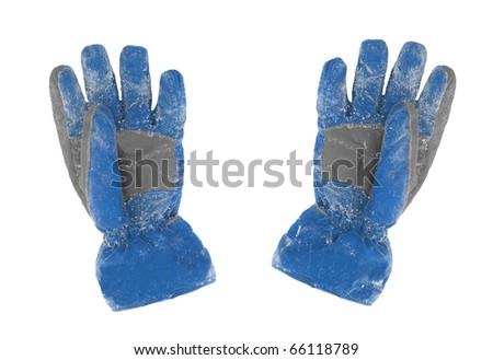 A pair of snowy gloves - stock photo