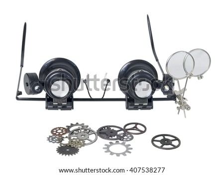 A pair of Steampunk glasses used to magnify the fine print with a variety of gears - path included - stock photo