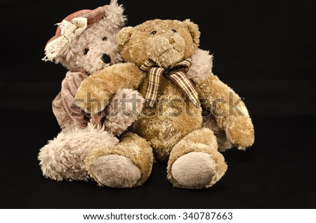 A pair of teddy bears in embrace. Mr. and Mrs. bear.  - stock photo