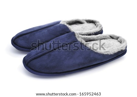 a pair of warm slippers on a white background - stock photo
