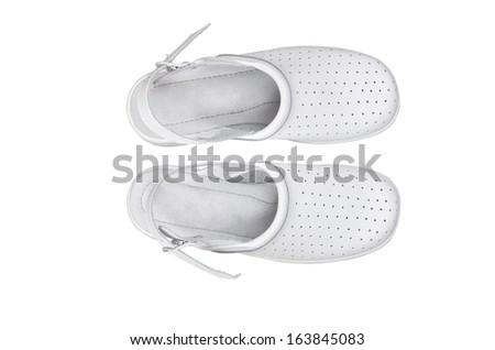 A pair of white professional ventilated work clogs isolated over white - stock photo