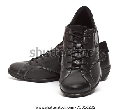 A pair of woman's sport shoes isolated on the white background - stock photo