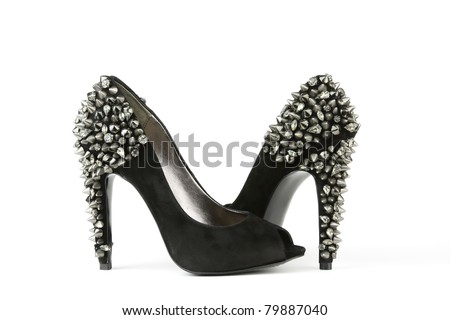 A pair of women's black high heel shoes on white - stock photo