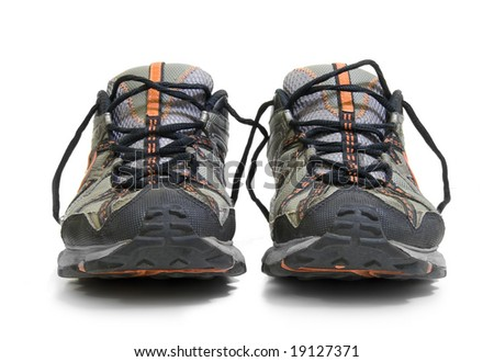 A pair of worn trainers or sneakers on white - stock photo