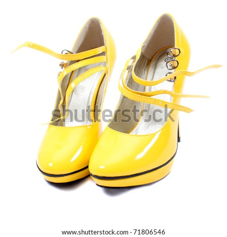 a pair of yellow women's shoes - stock photo