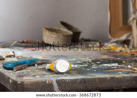 A palette board with a tubes of paint - stock photo