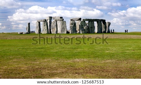 A panorama of Stonehenge in England with fluffy clouds in the background. - stock photo