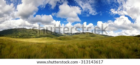 A panorama of the Highlands of Scotland during summer - stock photo