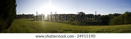 a panorama of the lush green countryside - stock photo