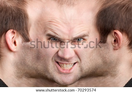A panoramic face of very malicious man - stock photo