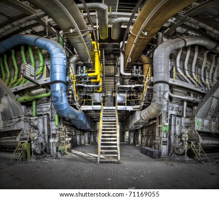 A panoramic image of a tubeline connection point at an abandoned factory - stock photo