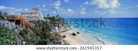 A Panoramic of Mayan ruins of Ruinas de Tulum (Tulum Ruins) and El Castillo at sunset, with beach and Caribbean Sea, in Quintana Roo, Yucatan Peninsula, Mexico - stock photo
