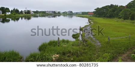 A panoramic view of a  salt marsh on Cape Cod in the town of Centerville, Massachusetts. - stock photo