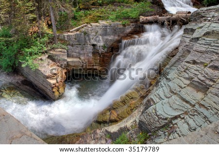 A panoramic view of a waterfall in Glacier National Park, Montana - stock photo