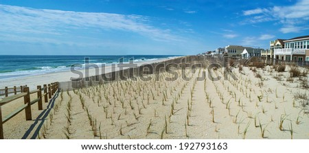 A panoramic view of the beach with freshly planted sand dunes in Surf City along the Jersey shore. - stock photo