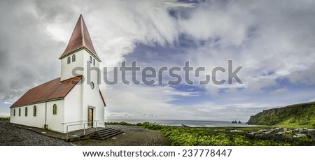 A panoramic view of the chuch and town of Vik, Iceland - stock photo